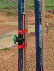 Cheap land surveying instrument: close up of the in line tap of a hose level